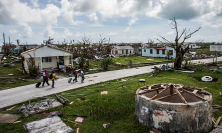 Residents of Codrington and Red Cross workers survey damage on the island of Barbuda in the aftermath of Hurricane Irma