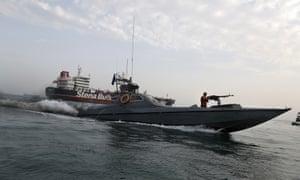 A speedboat of Iran's Revolutionary Guard circles British-flagged oil tanker Stena Impero.