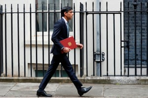 The chancellor, Rishi Sunak, leaves 11 Downing street to unveil the mini-budget.