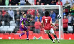 Manchester United's Uruguayan striker Edinson Cavani scores the opening goal.