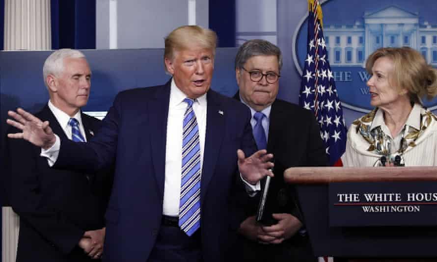 President Trump gestures as he asks a question of Dr Deborah Birx, White House coronavirus response coordinator at Monday's marathon briefing.