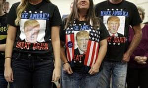 People wear Donald Trump shirts before a rally in Council Bluffs, Iowa, on Wednesday.