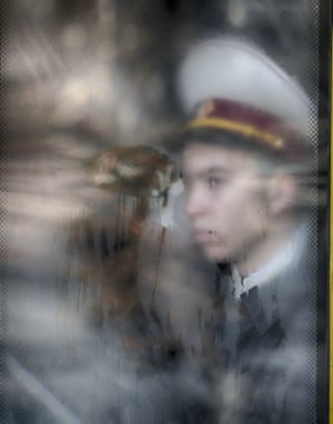 A cadet looks through a bus window prior to an oath-taking ceremony in front of the cathedral of St Sofia in Kiev, Ukraine