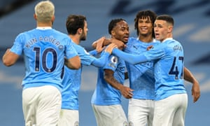 Manchester City celebrate after the decisive goal against Arsenal.