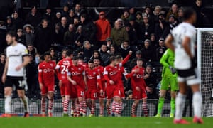 Barnsley celebrate scoring their third goal in the win at Fulham.