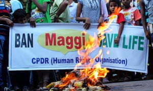 Indian students and activists burn Maggi brand noodles packets
