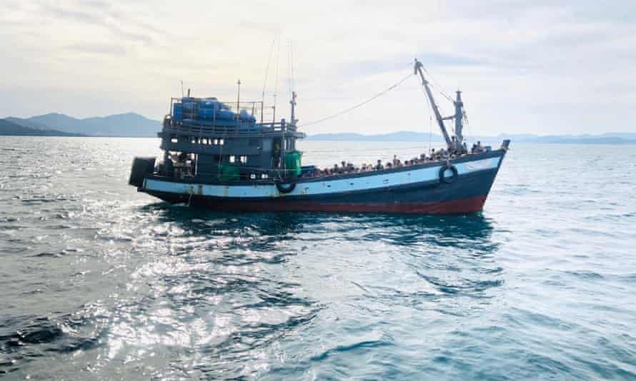 A boat thought to be carrying Rohingya migrants is detained off Malaysian earlier in April. Many Rohingya are desperate to seek jobs and education outside refugee camps.