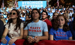 Supporters look on as Hillary Clinton speaks during a campaign rally in Pittsburgh.