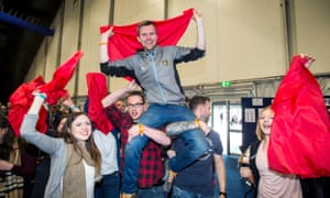 Gerry Carroll of People Before Profit Alliance celebrates after being elected as MLA for Belfast West, at the Titanic Exhibition Centre in Belfast