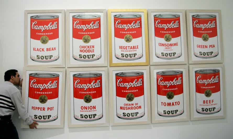 A worker hangs a print of Andy Warhol's Campbell's soup at a museum in Palma de Mallorca. The Andy Warhol Foundation closed its authentication board following a costly lawsuit.