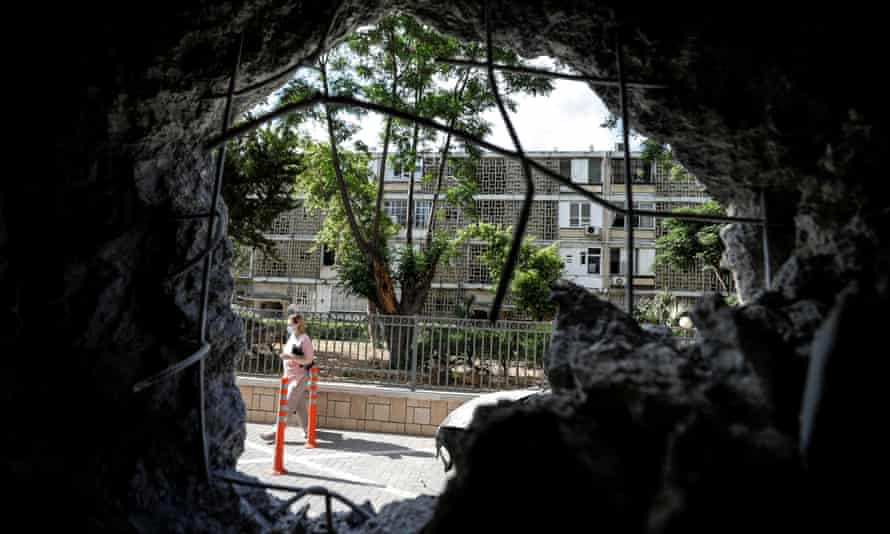A hole in a wall of a residential building in Ashkelon caused by a rocket launched from Gaza