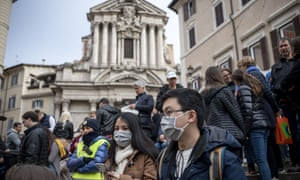 Tourists in face masks near the Trevi Fountain in Rome