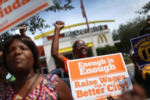 Outside a McDonald's in Fort Lauderdale, Florida, protesters rally in support of a $15 an hour minimum wage.