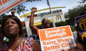 Protesters demonstrate in front of a McDonald's restaurant in Fort Lauderdale, Florida, in support of a $15 an hour minimum wage in 2015.