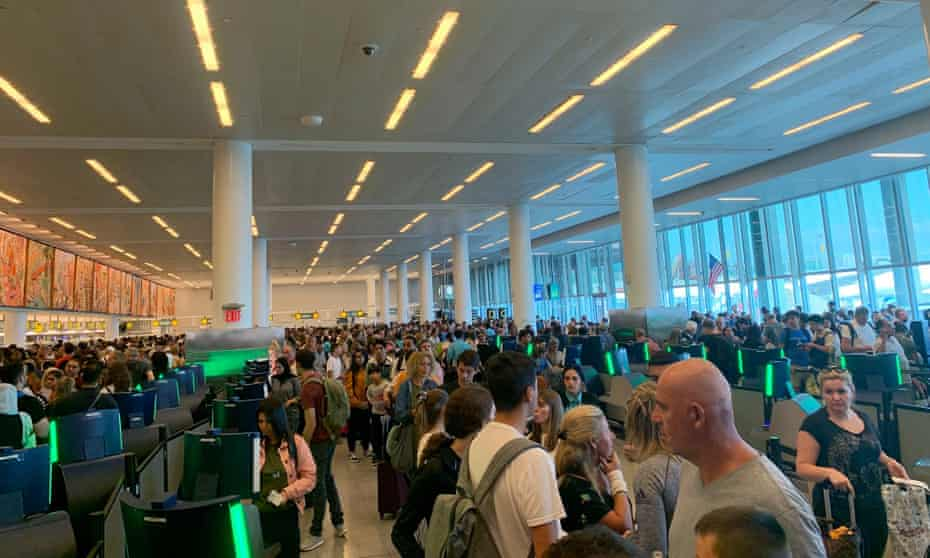 Travelers stand in long lines to clear customs at JFK international airport on Friday, in this photo from the Twitter user Brenna but in Leo Season.