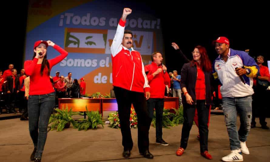 President Nicolás Maduro raises his fist during a socialist party rally in Caracas on Monday.