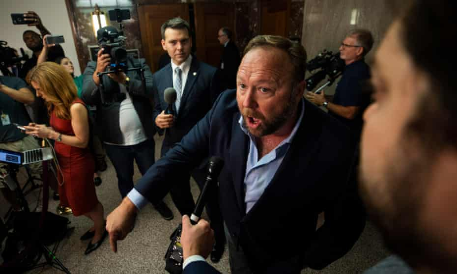 The radio host and conspiracy theorist Alex Jones speaks to the media outside of a Senate committee hearing with Twitter and Facebook executives.