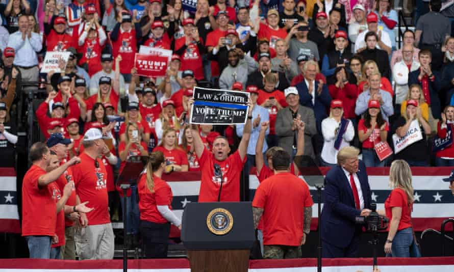 Trump supporters on stage at the rally in Minneapolis.