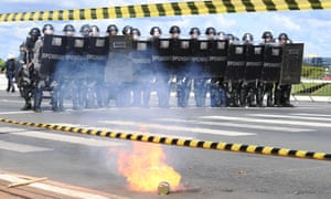 Riot police monitor protests against the government of Michel Temer in Brasilia, May 2017