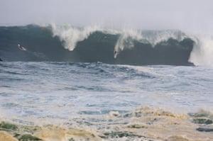 Greg Long, of California, rides a wave