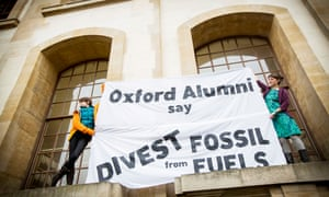 Oxford Alumni supporting fossil fuel divestment stage a protest and sit-in in the Clarendon Building, Oxford University.