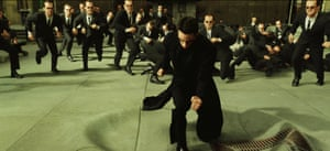 Action overload … multiple agents, played by Hugo Weaving, attack Keanu Reeves in The Matrix Reloaded.
