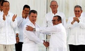 Santos and Timochenko shake hands