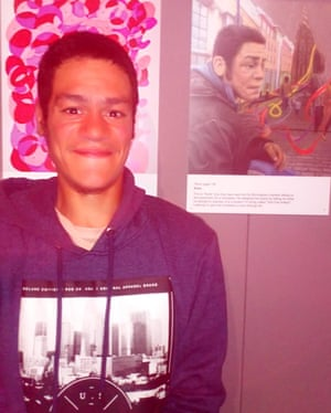 Kane in 2018 alongside Oliver Obee's portrait of him, on display in Birmingham Museum and Art Gallery.