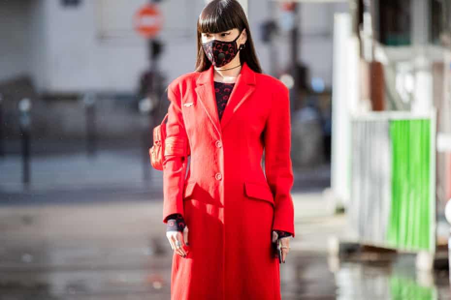 Model Kozue Akimoto heads to the Marine Serre show.