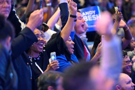 Supporters react to election results during the watch party for Andy Beshear in Louisville, Kentucky.