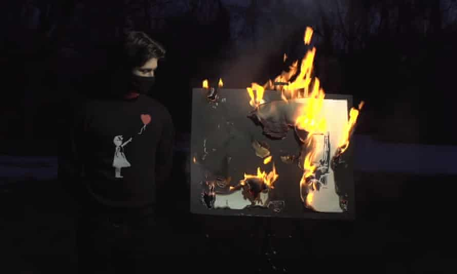 The burning of the Banksy print Morons.