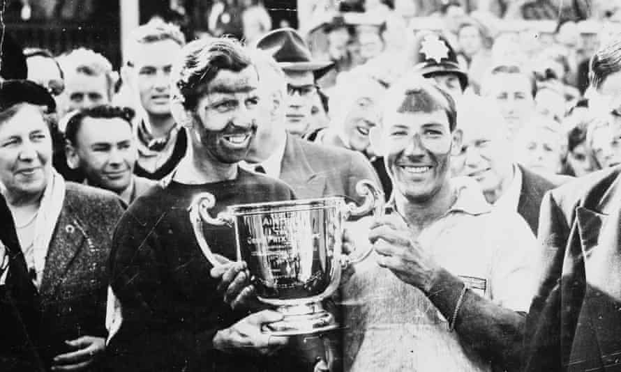 Stirling Moss, right, and his team-mate Tony Brooks, after winning the British Grand Prix at Aintree, 1957.