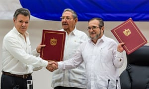 The signing ceremony of an historic ceasefire agreement between Colombian president Juan Manuel Santos (L) and Timoleon Jimenez (R), the top leader of the Revolutionary Armed Forces of Colombia (FARC) in June.