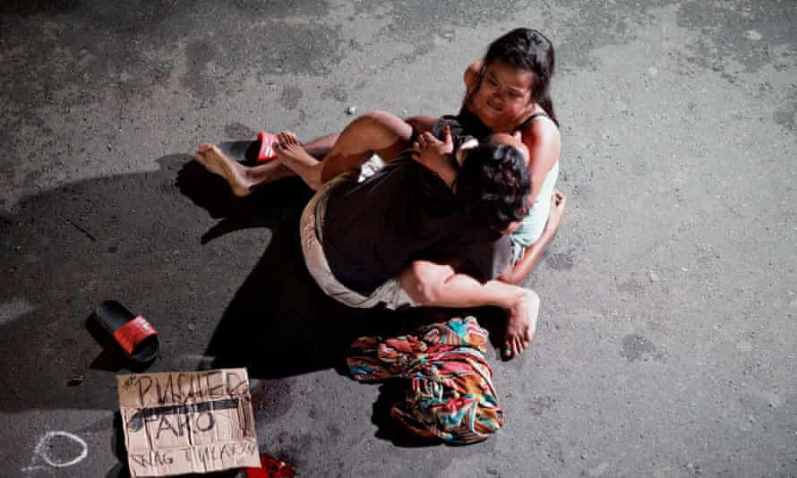 Jennelyn Olaires cradles the body of her husband, Michael Siaron