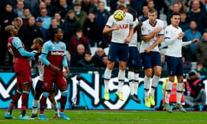 Tottenham Hotspur's English striker Harry Kane is hit in the face by the ball.