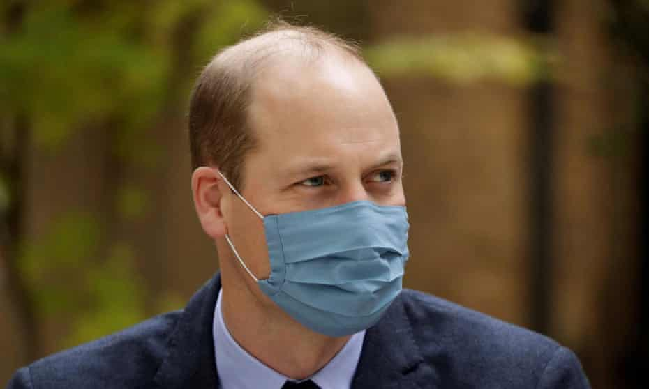 Prince William wears a protective mask on a visit to Bartholomew's hospital, London, in October.