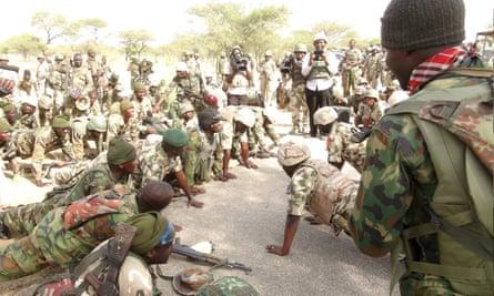 Nigerian army soldiers prepare to fight Boko Haram in Borno state.