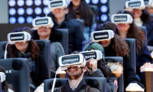 People test virtual reality Samsung Gear VR glasses at the Grand Palais exhibition hall