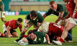 Frans Malherbe of South Africa scores his team's tenth try.