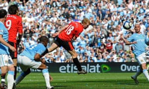 Paul Scholes heads a late winner against Manchester City in April 2010.