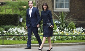 David Cameron and wife Samantha arrive back at Downing Street on Friday morning.
