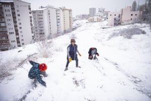 Children enjoy a fresh snowfall in the Keklikpinari district of Ankara in Turkey