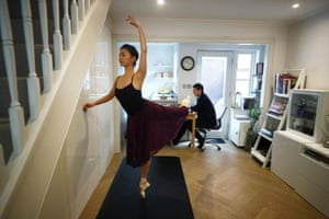 Yuhui Choe, first soloist of the Royal Ballet practises as her husband, former principal of the Royal Ballet Nehemiah Kish ,works at their home in Wimbledon, following the outbreak of the coronavirus disease