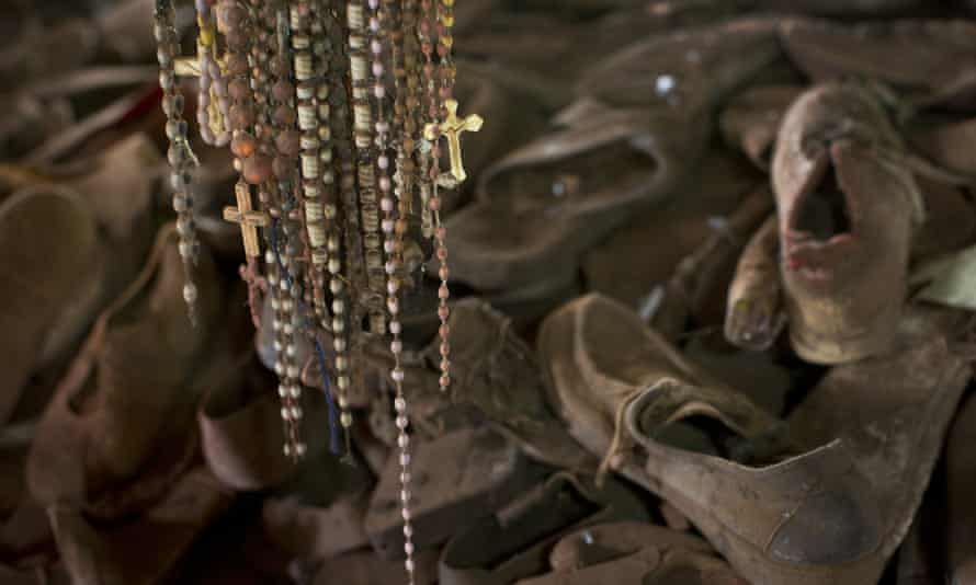 A 2014 file photo showing necklaces and crucifixes hanging over a pile of shoes belonging to some of those who were slaughtered as they sought refuge inside the church