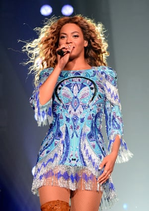 Beyoncé. wearing a custom-made blue dress and boots by Pucci, in New York during her 'Mrs Carter Show World Tour' in 2013.