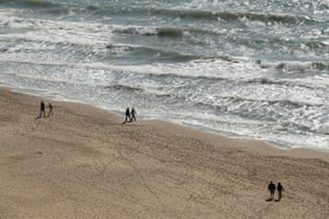People walk on Bournemouth beach