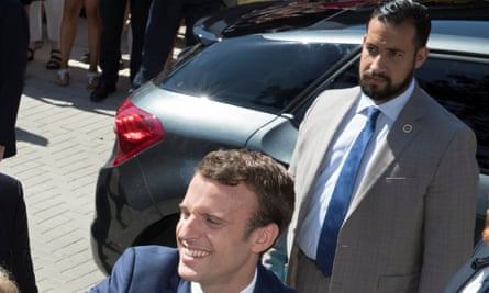 Alexandre Benalla stands behind Emmanuel Macron, before he was sacked as the French president's personal protection officer.