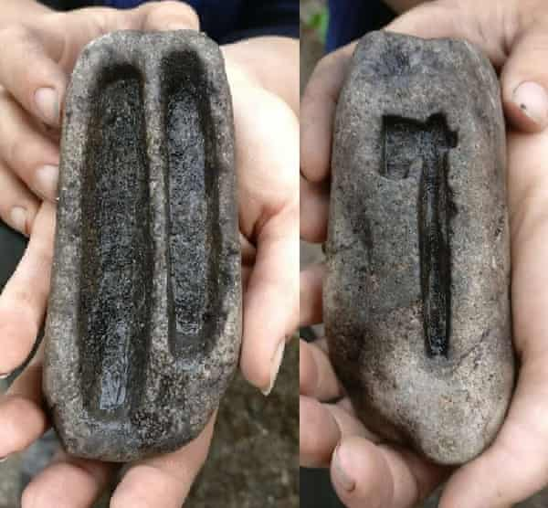 Mould carved from soapstone for making ingots and and an axe amulet, both discovered at Ribe.