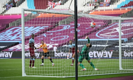 Pedro Neto sends a volley into the roof of the West Ham net.