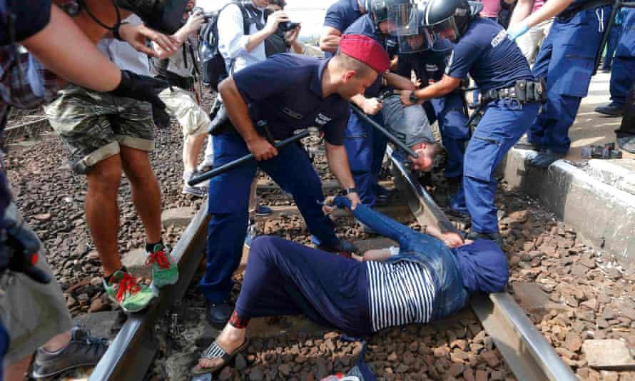 Hungarian police detain refugees on the tracks at Bicske station.